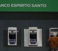 A man uses an automated teller machine of Portuguese bank Banco Espirito Santo in downtown Lisbon