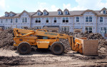 Workers Build a Housing Complex Ahead of Construction Spending Data