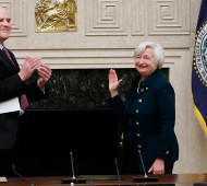 Federal Reserve Board Governor Tarullo applauds new Federal Reserve Board Chairwoman Yellen after administering the oath of office at the Federal Reserve Board in Washington