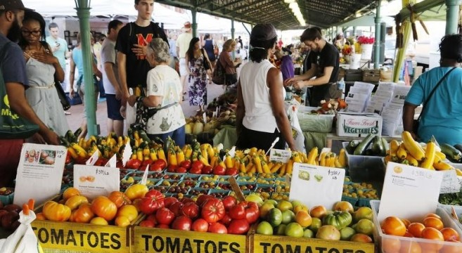 People shop at a farmer's market in the Capitol Hill neighborhood in Washington